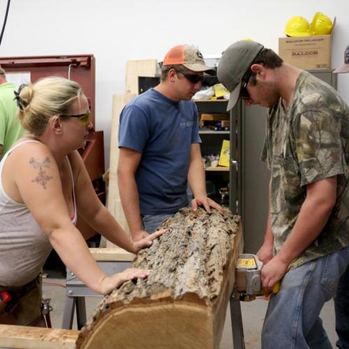Carpentry class turns a log into a table for the Frontier History Encampment